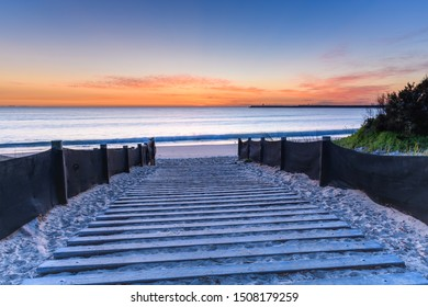 Sunrise Seascape and Steps down to the Beach - from Stockton Beach, Stockton in Newcastle, NSW, Australia.