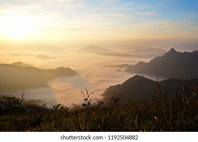 Sunrise shade. Morning time in winter at Phu Chee Fa, Chiang Rai, Thailand. Amazing place in Thailand with foggy at the cliff of Mountain.