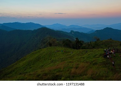 Sunrise shade in winter. Trekking or hiking in  morning time at Phu Chee Fa, Chiang Rai, Thailand. Amazing place in Thailand with light foggy at many layers of mountains.