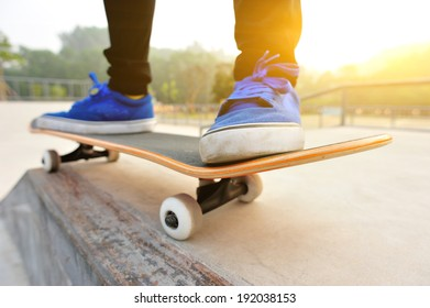 sunrise skateboarding woman legs