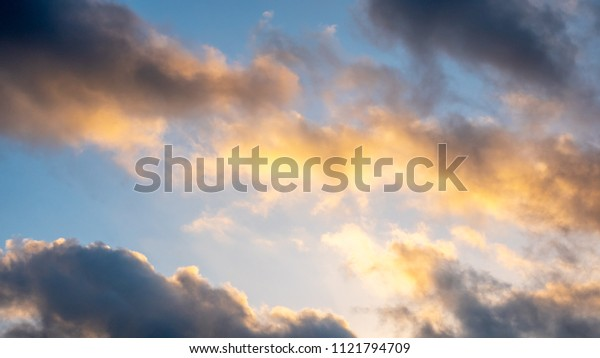 Sunrise Skies with Storm Clouds