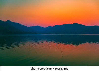 Sunrise sky over the lake in the morning. Thailand.