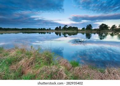 sunrise sky reflected in lake, North Brabant, Netherlands