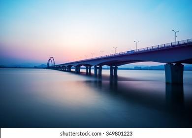 sunrise skyline and landscape of bridge over river