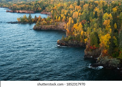 Sunrise slowly begins to light up the rocky shoreline of Tettegouche State Park along Minnesota's north shore of Lake Superior.