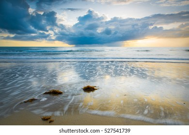 Sunrise and a small shower over Four Mile Beach in Port Douglas, Queensland, Australia.