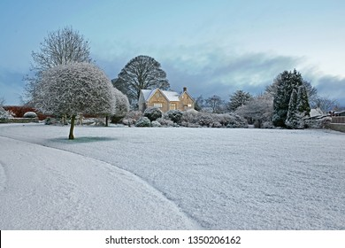Sunrise and a  snowy winter scene in the heart of the Cotswolds, Gloucestershire, England, United Kingdom