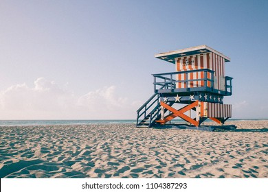 Sunrise in South Beach with the sea and a baywatch tower