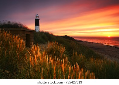 Sunrise at Spurn Point Lighthouse. The light house is called Spurn Low which is nestling in the sand dunes on the Humber estuary.