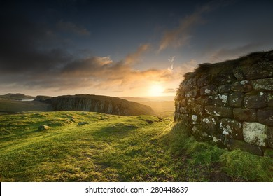 Sunrise at Steel Rigg in Northumberland. Hadrian's Wall is visible prominently in the foreground, as well as into the distance in the background.
