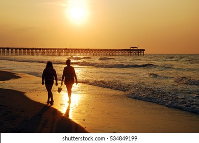 A sunrise stroll along the shore in Myrtle Beach, South Carolina