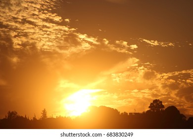 Sunrise with sun, Large solar disk on the horizon, intense orange, white and yellow colors, sunset, sun dawn,
