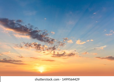 Sunrise sundown sky with soft clouds and sunbeams, sky wallpaper