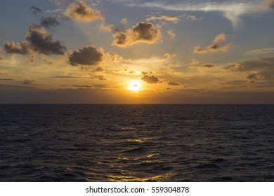 Sunrise, sunset background. Gold sky and sea water in the Gulf of Thailand