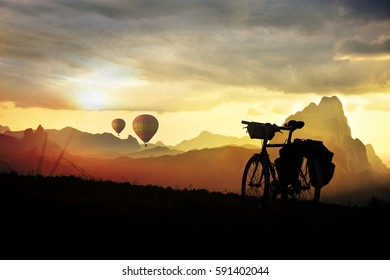 Sunrise and  sunset, Cycling around the world Is a journey to freedom.
