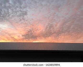 Sunrise sunset over metal tin roof