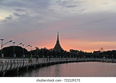 Sunrise or sunset with silhouette Religious places of Buddhism  with Marsh ,The bridge and beautiful sky