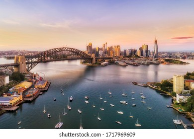 Sunrise in Sydney city - aerial view from Lavender bay to the Sydney harbour bridge and CBD skyline.