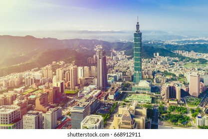 Sunrise of Taipei city at dawn with Taipei 101 and mountain in background, Taiwan