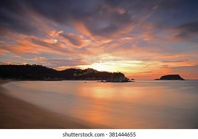 Sunrise at Tangolunda bay in the famous beach resort of Huatulco, Mexico.