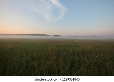 sunrise in thick fog
