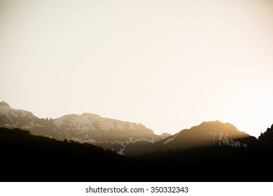 Sunrise - This is a beautiful image of the warm sun streaming through the mountain peaks in Telluride, Colorado. Shot with a warm color tone.