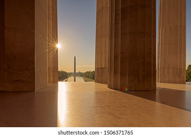 Sunrise through Lincoln Memorial Architectural Column with Washington Monument in Background