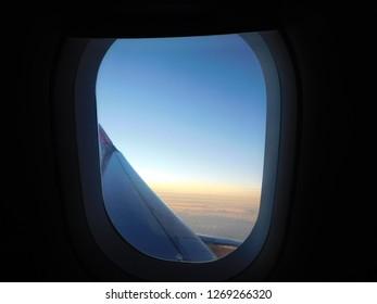 Sunrise through plane window
