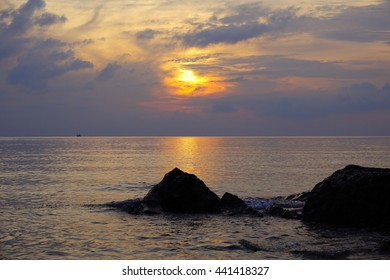 sunrise time at the sea with silhouette little island and beach on foreground:select focus with shallow depth of field:ideal use for background.