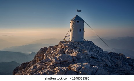 Sunrise from Triglav the highest peak in Triglav National park. Mountain landscape photography.