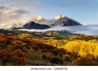 Sunrise at Twin mountain View of Mount Sopris and Mount Elk with Fall color and morning mist, Snowmass Maroon Bells Wilderness area, Colorado