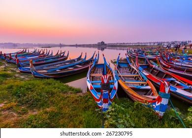 Sunrise at U Bein Bridge with boat, Mandalay, Myanmar.
