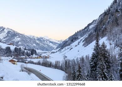 sunrise in valley großarl in austria in winter on sunny day