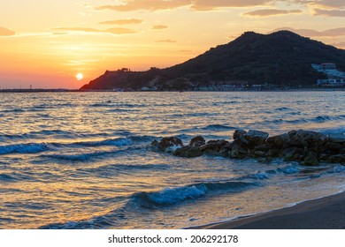 Sunrise view from beach. Summer coastline (Greece, Zakynthos, Alykes, Ionian Sea).