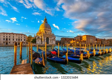 Sunrise view of Canal Grande with Venice gondola and Basilica di Santa Maria della Salute in Venice, Italy