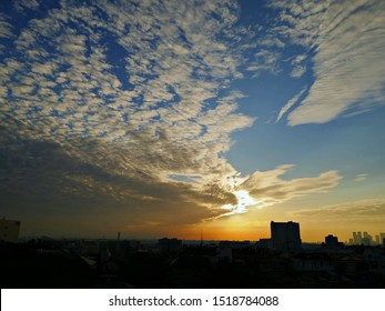 sunrise view with the cloud which shape is like cotton ball spread over the sky and the cityscape of Tokyo / kanagawa area during summer season