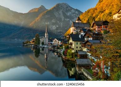 Sunrise view of famous Hallstatt mountain village with Hallstatter lake, Austria.