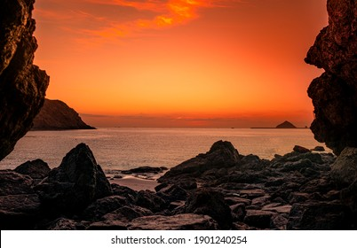 Sunrise view form Khorfakkan heart beach cave Sharjah, hidden Place in United Arab Emirates, Travel and Tourism Concept image