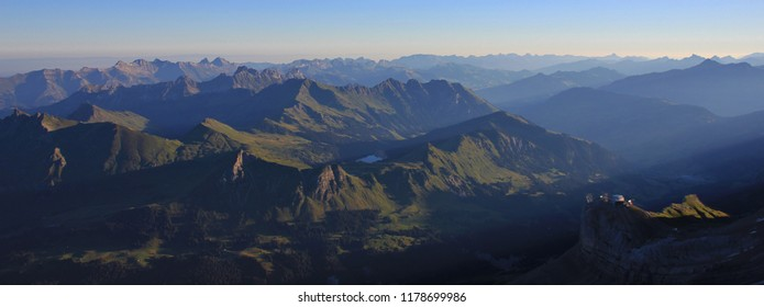Sunrise view from Glacier 3000, Switzerland. Mountain ranges and Lake Arnen.