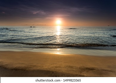 sunrise view at the Lake Malawi, waves rolling smoothly on the beach, Africa