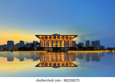 Sunrise view at Masjid Besi (Iron Mosque) or Masjid Tuanku Mizan Zainal Abidin, Putrajaya, Malaysia with reflection