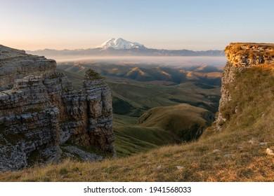 Sunrise view of mount Elbrus from Bermamyt plateau. Karachay-Cherkessia, Caucasus, Russia.