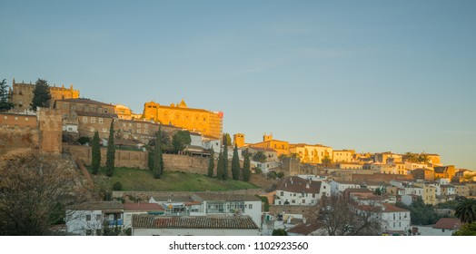 Sunrise view of the old city and its walls, in Caceres, Extremadura, Spain