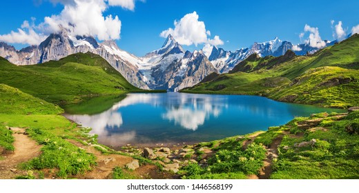Sunrise  view on Bernese range above Bachalpsee lake. Popular tourist attraction. Location place Swiss alps, Grindelwald valley, Europe.