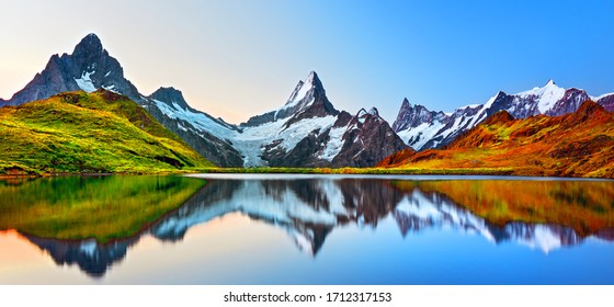 Sunrise view on Bernese range above Bachalpsee lake. Peaks Eiger, Jungfrau, Faulhorn in famous location in Switzerland alps, Grindelwald valley