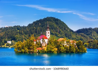 Sunrise view On Bled Lake, Island,Church And Castle With Mountain Range (Stol, Vrtaca, Begunjscica) In The Background-Bled, Slovenia, Europe