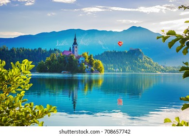 Sunrise view On Bled Lake, Island,Church And Castle With Mountain Range (Stol, Vrtaca, Begunjscica) In The Background-Bled,Slovenia,Europe