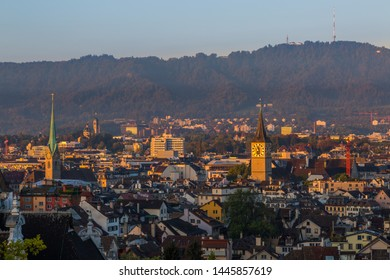 sunrise view on churches, roofs and Uetliberg of Zurich, Switzerland