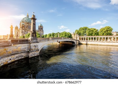 Sunrise view on the riverside with Dom cathedral and bridge in the old town of Berlin city