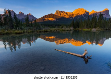 Sunrise view of Policeman's Creek along the Bow River outside Canmore, Alberta. Mount Lawrence Grassi with Ha Ling Peak on the far right of Mount Grassi.